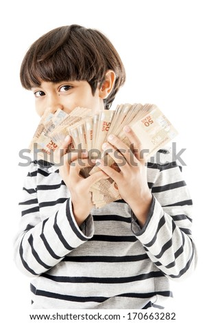 Young kid holding a lot money .