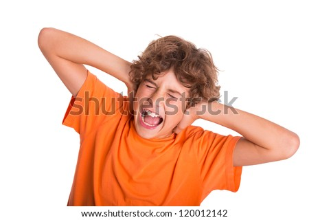 Young kid is frustrated by the noise around him - stock photo