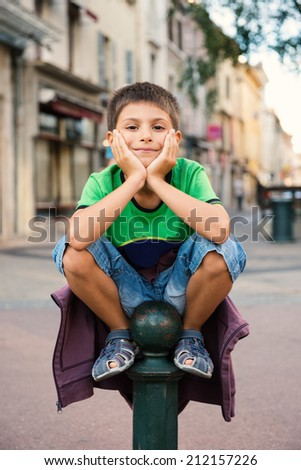 Young kid outdoors portrait.  - stock photo