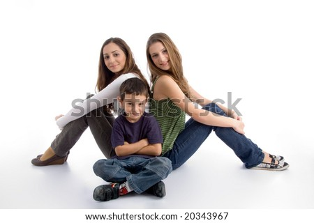 young kid sitting with teenagers on an isolated white background - stock photo