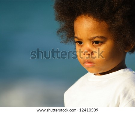 Young kid with blue background - stock photo