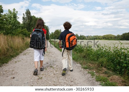 Young kids going to school - stock photo