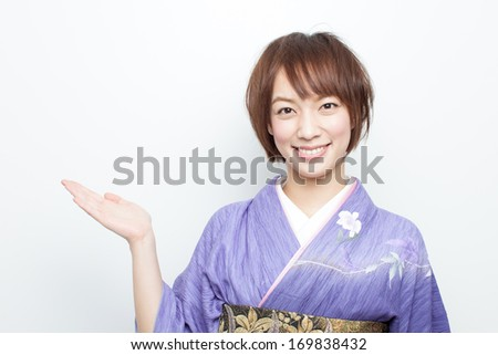 young kimono woman showing copy space
