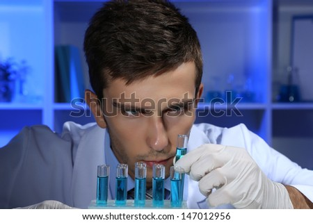 Young laboratory scientist working at lab - stock photo