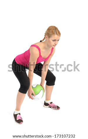 Young lady doing medicine ball workout - stock photo