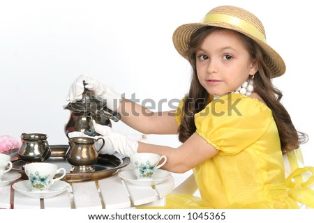 young lady dress for tea in brite yellow with hat - stock photo
