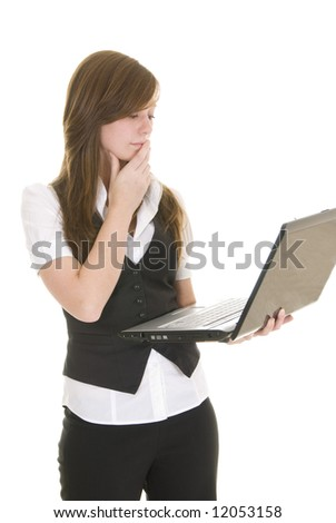 Young lady dressed in black and white business attire isolated on white background, holding a laptop computer.