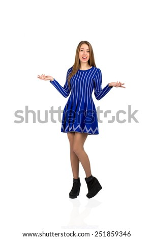 Young lady expressing amazement. Young Caucasian female expressing surprise and amazement with thrown opened hands. - stock photo