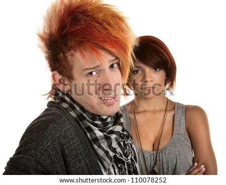 Young lady frustrated with boyfriend in orange hair - stock photo
