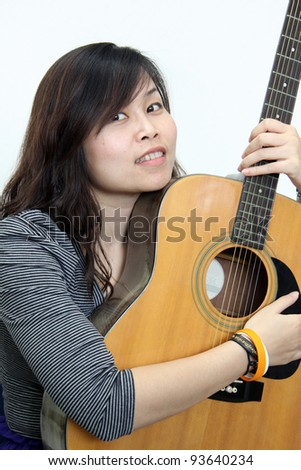 Young Lady holding a guitar - stock photo