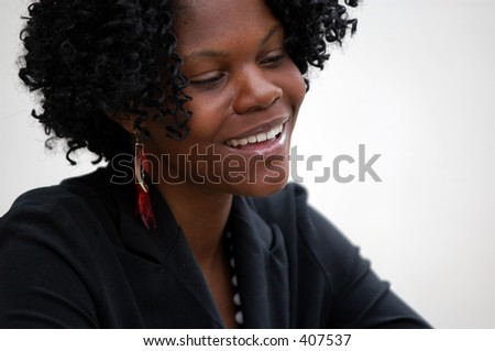 young lady in business attire smiles - stock photo