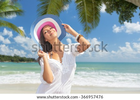 YOung  lady is relaxing on a tropical beach - stock photo