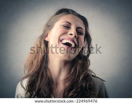 Young lady laughing  - stock photo
