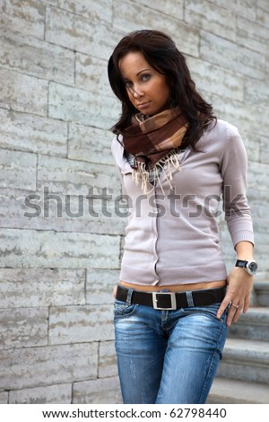 Young lady over the stone wall - stock photo