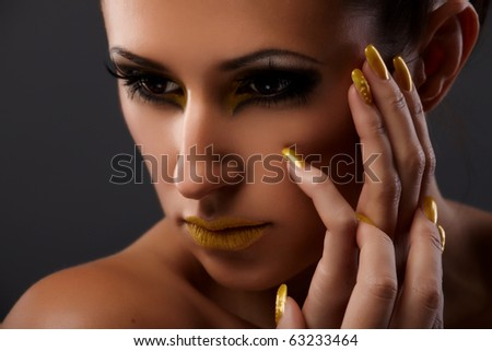 Young lady portrait with fantasy makeup on grey background - stock photo