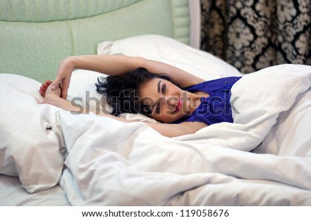 young lady posing in camera waking up - stock photo