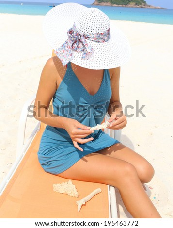Young lady relaxing in a chair on a beach