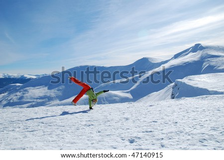 Young lady snowboarder - stock photo