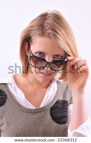 Young lady taking off sunglasses
