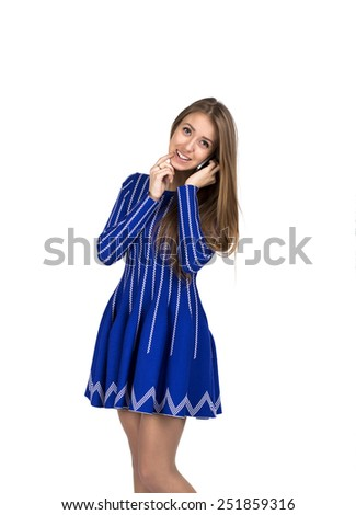 Young lady talking on the phone. Caucasian lady talking on the phone and expressing excitement and amazement. She is in bright blue dress, smiling and cheerful - stock photo