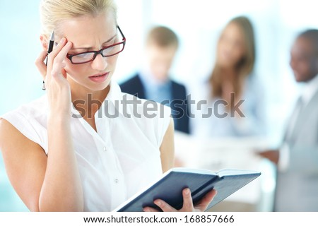 Young lady trying to recall her plans for the day - stock photo