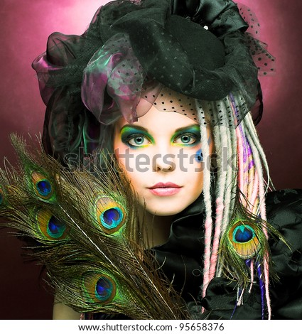 Young lady with creative make-up in vintage hat - stock photo