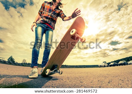 Young lady with skateboard - stock photo