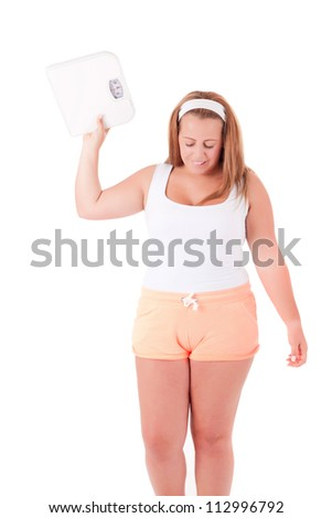 Young large woman with a scale - Diet Concept
