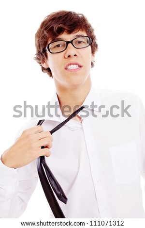 Young latin man in black glasses and white shirt with passion tearing off his tie. Isolated on white background, mask included