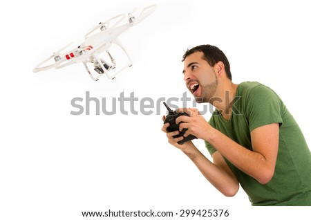 young latin man with playing quadcopter drone isolated on white - stock photo