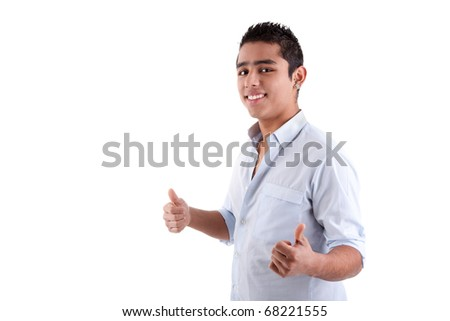 Young latin man with thumbs raised as a sign of ok, isolated on white background. studio shot - stock photo