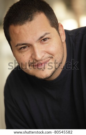 Young Latino man smiling