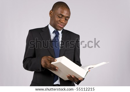 Young lawyer or business man reading a big book