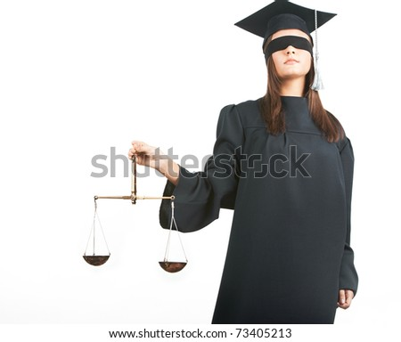 Young lawyer with closed eyes holding scales - stock photo