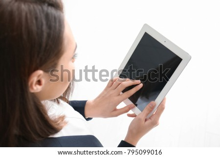Young lawyer with tablet computer indoors