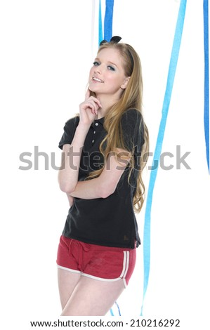 young leisure woman in shorts with blue and hat ribbons posing   - stock photo