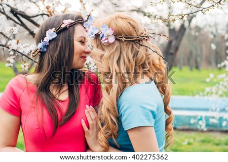 young lesbian couple kissing  in park - stock photo