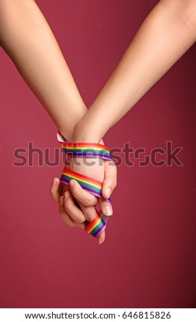 image Two colorful lesbians using toys and candies for gaping