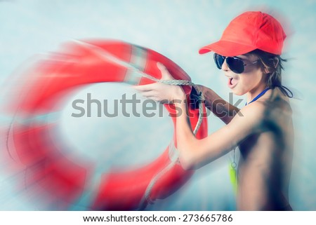 young lifeguard boy - blurred style photo - stock photo