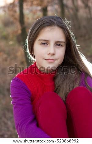 Young little girl posing in autumn