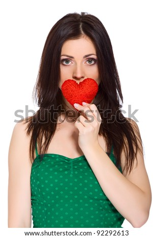 young lonely sad girl holding red valentine heart; isolated on white background, concept of negative valentine's day