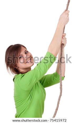 young, long hair, woman climbing on grey rope - stock photo