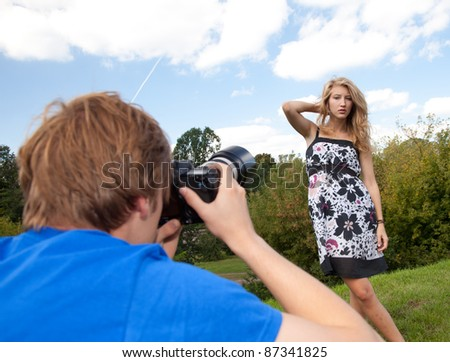 young long hair woman in dress posing in the park - stock photo
