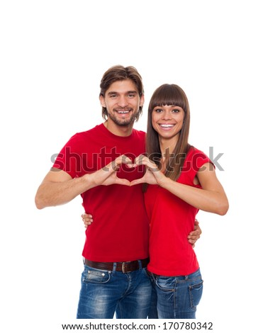 young love couple hold hands heart shape gesture, happy smile embrace, wear red shirt isolated over white background, valentine day concept