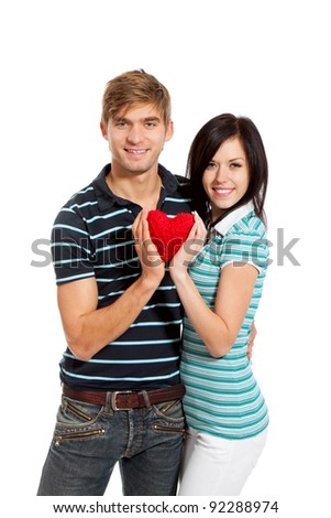 young love couple holding red heart together, happy smile looking at camera, hug, isolated over white background, valentine day concept - stock photo