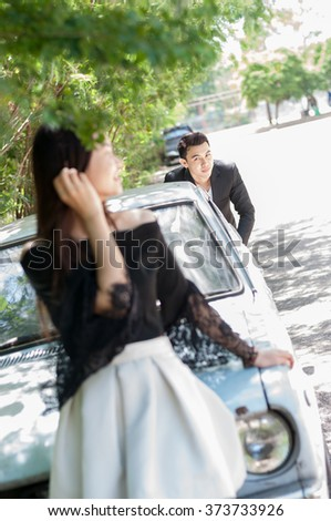 Young love Couple smiling in the park - stock photo
