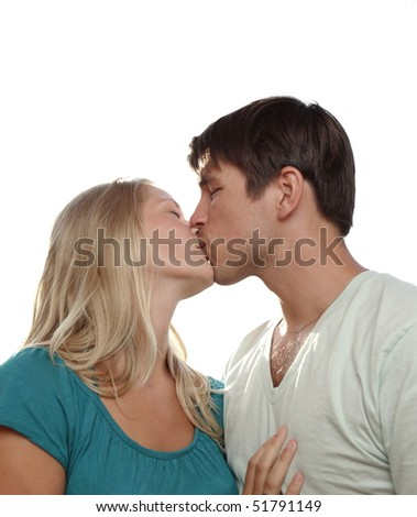Young lovely couple kissing lovingly - isolated on white