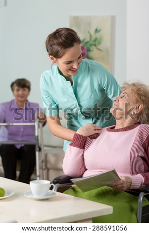 Young lovely therapist worried about her patient - stock photo