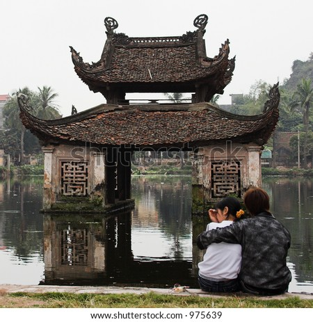 Young lovers at water temple ruins - stock photo