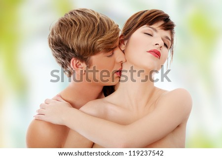 Young lovers intimate kiss - stock photo